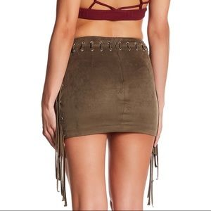 Skirts - Faux suede lace up fringe mini skirt